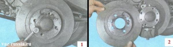 Выворачивание направляющих штифтов и снятие тормозного диска с автомобиля