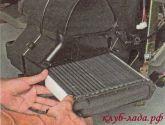 Вытащить радиатор Калины из корпуса отопителя