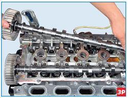 Изъятие из постелей головки блока цилиндров вала выпускных клапанов Lada Largus